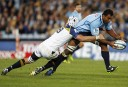 Wycliff Palu of the NSW Waratahs is tackled by Ben Mowen of the Brumbies. (Photo: Paul Barkley/LookPro)