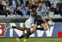 Adam Ashley-Cooper of the NSW Waratahs is tackled by Henry Speight of the ACT Brumbies. (Photo: Paul Barkley/LookPro)