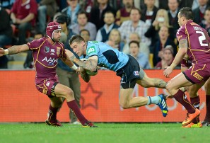Queensland's Johnathan Thurston (left) blocks NSW's Josh Dugan during 2013 State of Origin Game 2