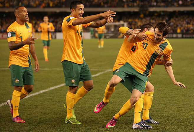 Robbie Kruse (right) of Australia. (AAP Image/Mark Dadswell)