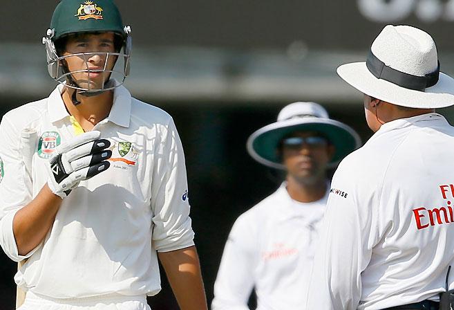 Ashton Agar queries the umpires at Lord's