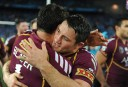 Queensland Maroons' Billy Slater (left) and Copper Cronk celebrate winning State of Origin 2013 (AAP Image/Dean Lewins)