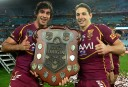 Queensland Maroons' Johnathan Thurston and Billy Slater hold the Holden State of Origin shield as they celebrate their win