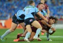 Queensland Maroons' Sam Thaiday takes a hit against the Blues during State of Origin Game 3 (AAP Image/Dean Lewins)