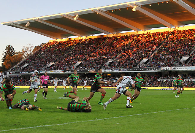 Konrad Hurrell scores in front of a ground record crowd during the Round 17 NRL match between the South Sydney Rabbitohs and the New Zealand Warriors at NIB Stadium in Perth