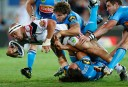 Sam Rapira attempts to muscle his way through the Gold Coast Titans defence