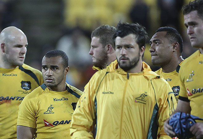 Australias' Will Genia and the rest of the team dejected after the Round 2 Bledisloe Cup match between the All Blacks and the Wallabies at Westpac Stadium in Wellington, New Zealand, Saturday, Aug. 24