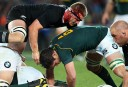 Sam Cane of New Zealand (top) and Francois Louw of South Africa (C) compete for the ball during the Rugby Championship Test rugby union match between the New Zealand All Blacks and South Africa Springboks at Eden Park. AFP PHOTO / Michael Bradley