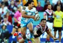 Gold Coast Titans' Kevin Gordon runs away from Sonny Bill Williams of the Roosters