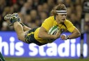 Nic Cummins dives over in the Wallabies' 32-15 win against Ireland. (AP Photo/Peter Morrison)
