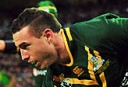 Australia's Darius Boyd scores their second try during the 2013 Rugby League World Cup semi-final match between Australia and Fiji at Wembley Stadium in London, England on November 23, 2013. AFP PHOTO / GLYN KIRK