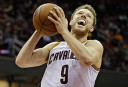 Cleveland Cavaliers' Matthew Dellavedova (9), from Australia, shoots against the Detroit Pistons in a preseason NBA basketball game Thursday, Oct. 17, 2013, in Cleveland. (AP Photo/Mark Duncan)