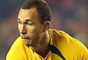 Wallabies flyhalf Quade Cooper, left, is tackled by Scotland's Sean Maitland, right, during the international rugby match at Murrayfield, Edinburgh, Scotland, Saturday Nov. 23, 2013. (AP Photo/Scott Heppell)