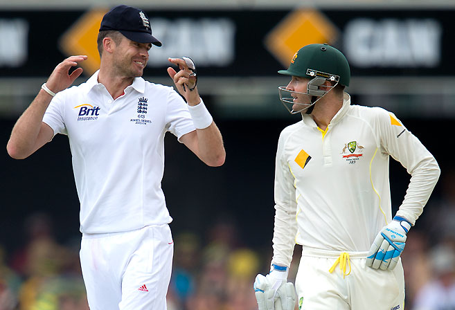 England bowler James Anderson and Australian batsman Michael Clarke share words. (AAP Image/Dave Hunt)