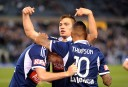 James Troisi celebrates with Melbourne Victory teammates after scoring
