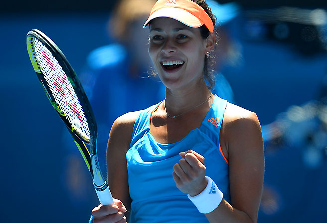 Ana Ivanovic celebrates after victory against Serena Williams AFP PHOTO / WILLIAM WEST