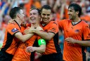Brisbane Roar players celebrate a goal against Melbourne Heart