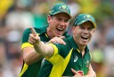 David Warner and James Faulkner celebrate taking Ian Bell's wicket at the SCG