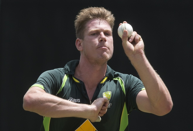 Australian cricketer James Faulkner bowls during the Australian team training session at the Gabba in Brisbane, Thursday, Jan. 16, 2014. Australia play England in the first One Day International at the Gabba tomorrow. (AAP Image/Dave Hunt) NO ARCHIVING