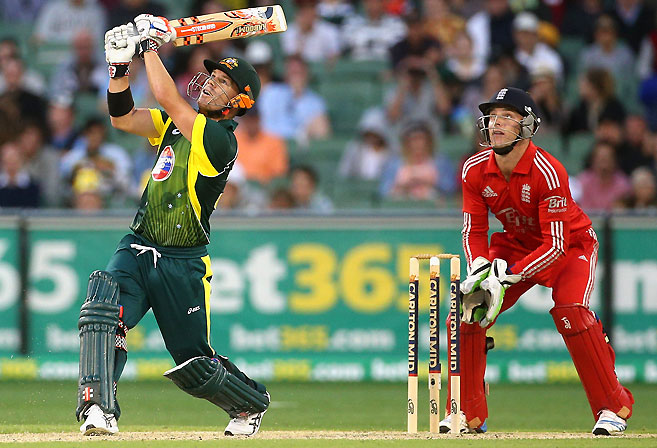 David Warner of Australia skies a shot. (AAP Image/Mark Dadswell)
