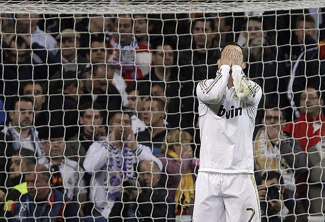 Real Madrid's Cristiano Ronaldo from Portugal reacts after falling to score a penalty kick during a shootout in a semifinal, second leg Champions League soccer match against Bayern Munich at the Santiago Bernabeu stadium in Madrid Wednesday April 25, 2012. (AP Photo / Franz Mann)