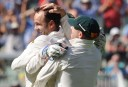 Australians (L-R) Brad Haddin, Nathan Lyon and David Warner embrace.(AAP Image/Julian Smith)