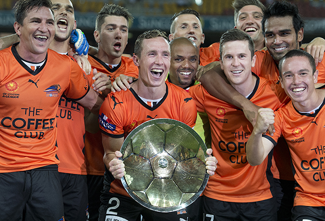 Roar captain Matthew Smith (centre) celebrates the teams minor Premiership following the Round 24 A-League match between the Brisbane Roar and Melbourne Victory at Suncorp Stadium in Brisbane, Saturday, March 22, 2014. (APP Image/Dave Hunt)