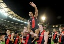 Nathan Lovett-Murray of Essendon is carried off the ground by team-mates.  (AAP Image/Joe Castro) <br /> <a href='http://www.theroar.com.au/2014/03/13/essendon-players-are-not-to-blame-in-drugs-scandal/'>Essendon players are not to blame in drugs scandal</a>
