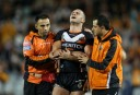 Robbie Farah leaves the field after dislocating his elbow