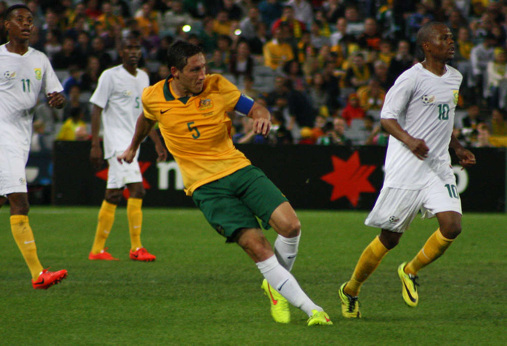 Socceroo Mark Milligan takes a shot on goal against South Africa
