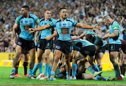 NSW Blues fullback Jarryd Haynes celebrates as his side win Game 1 of the 2014 State of Origin series 12-8 (AAP Image/Dan Peled)