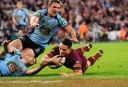 Cooper Cronk scores Queensland's fifth try in a 32-8 defeat of New South Wales in Game 3 of the 2014 State of Origin series <br /> <a href='http://www.theroar.com.au/2014/07/09/state-origin-game-3-full-time-result-qld-32-8-nsw/'>State of Origin Game 3: Full time result - QLD 32-8 NSW</a>