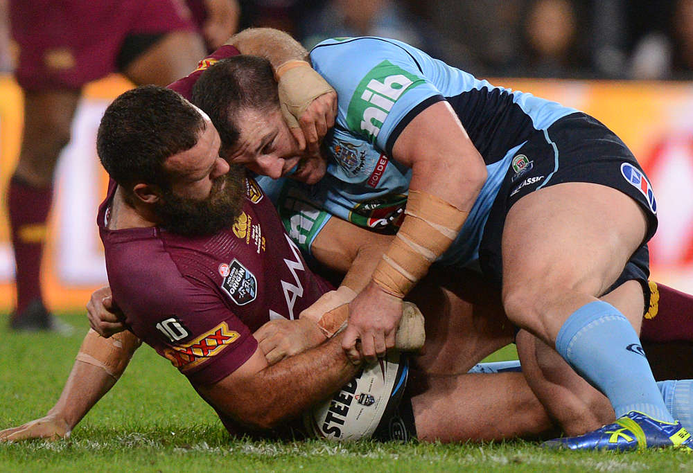Paul Gallen tackles Queensland player Nate Myles