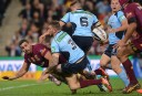 Greg Inglis releases a pass to Johnathan Thurston during Game 3 of the 2014 State of Origin series <br /> <a href='http://www.theroar.com.au/2014/07/09/state-origin-game-3-full-time-result-qld-32-8-nsw/'>State of Origin Game 3: Full time result - QLD 32-8 NSW</a>