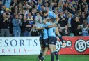 The Waratahs backs celebrate (Photo: Ashleigh Knight)