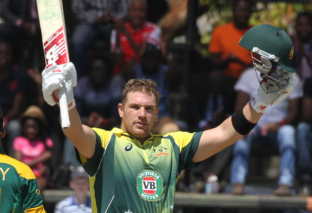 Australian batsman Aaron Finch celebrates after scoring a century, during the One Day International cricket match against South Africa in Harare Zimbabwe Wednesday, Aug. 27, 2014. The two teams are competing in a triangular ODI series with Zimbabwe. (AP Photo/Tsvangirayi Mukwazhi)