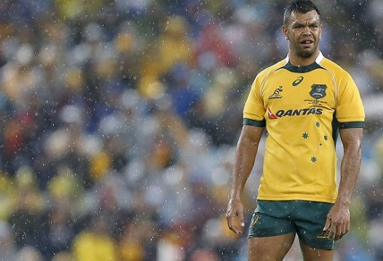 Kurtley Beale stands in a rain soaked opening game of the series between the Wallabies and the All Blacks at ANZ Stadium in Sydney, Saturday, Aug. 16, 2014. (Photo: Paul Barkley/LookPro)