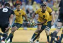 Kurtley Beale shapes to pass during the opening game of the series between the Wallabies and the All Blacks at ANZ Stadium in Sydney, Saturday, Aug. 16, 2014. (Photo: Paul Barkley/LookPro)