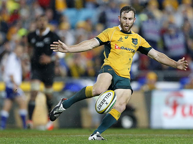 Nic White kicks the ball during the opening game of the series between the Wallabies and the All Blacks at ANZ Stadium in Sydney, Saturday, Aug. 16, 2014. (Photo: Paul Barkley/LookPro)