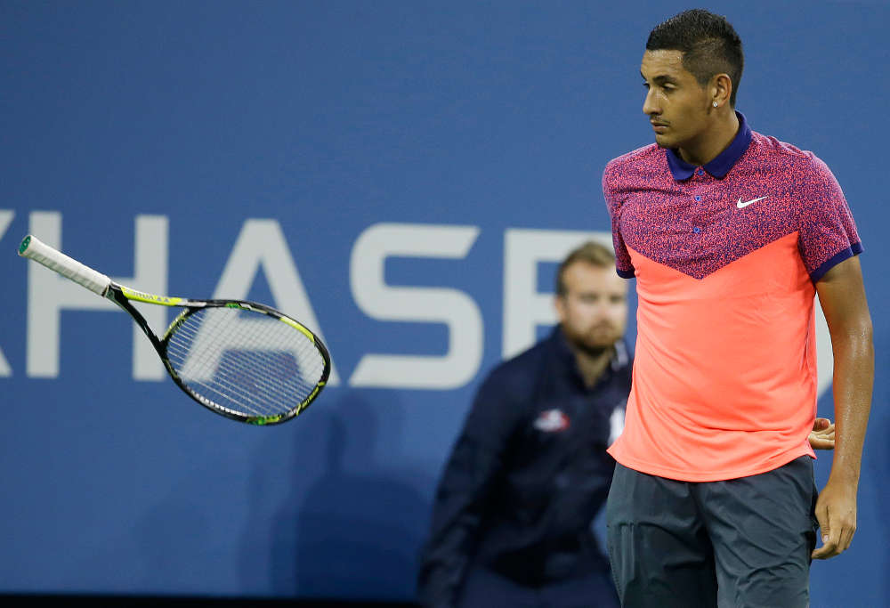 Nick Krygios throws his racquet against Tommy Robredo