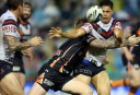 Roger Tuivasa-Sheck signs with the Warriors