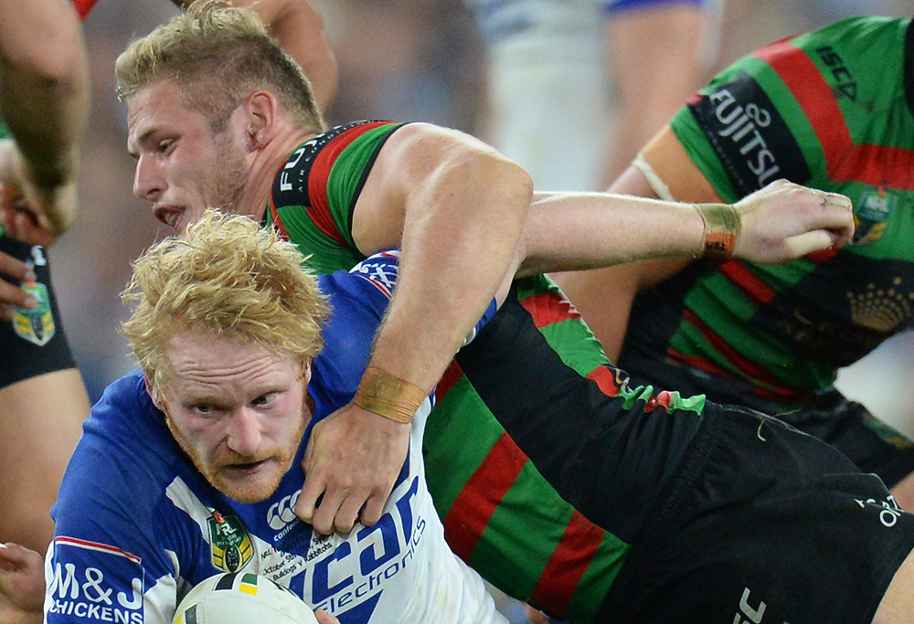 Bulldogs James Graham is tackled by the Rabbitohs Thomas Burgess