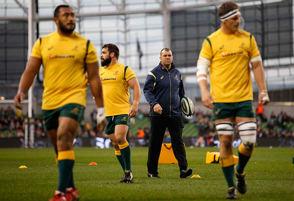 Australia's head coach Michael Cheika, second right, walks with his side before playing Ireland