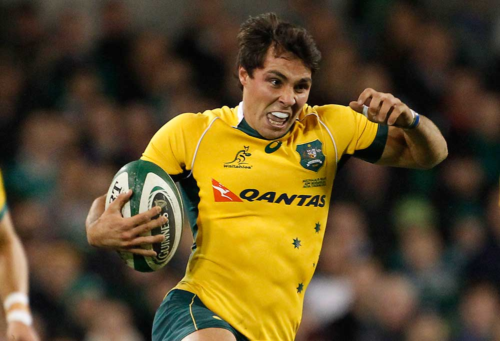 Australia's Nick Phipps is tackled by Ireland's Jonathan Sexton