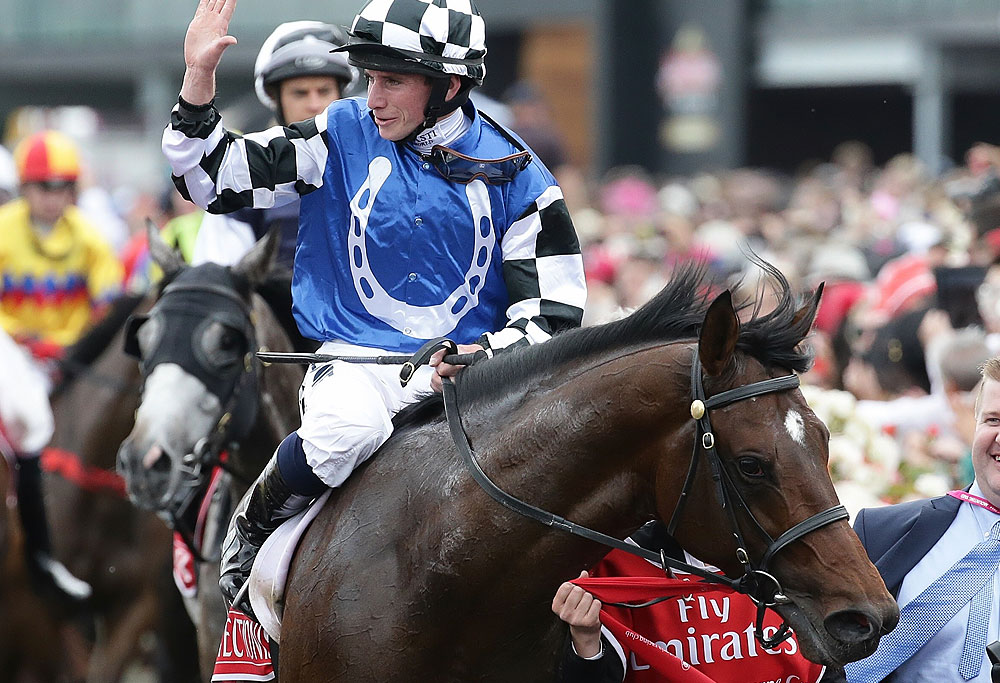 Ryan Moore and Protectionist return to scale after winning the Melbourne Cup 2014 at Flemington Racecourse