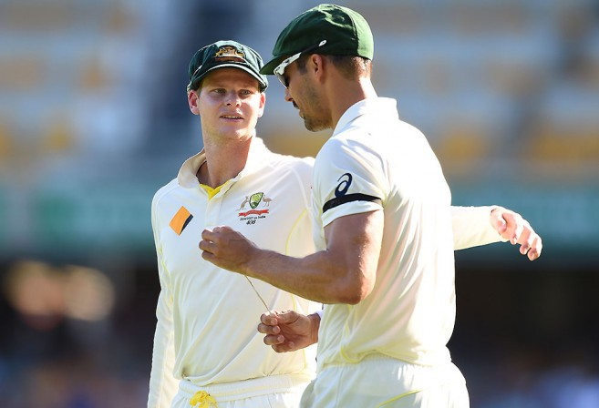 Australian captain Steve Smith (left) chats with bowler Mitchell Johnson