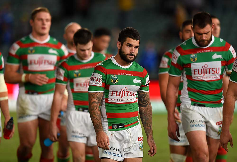 Adam Reynolds (centre) of the Rabbitohs leads the team off the field