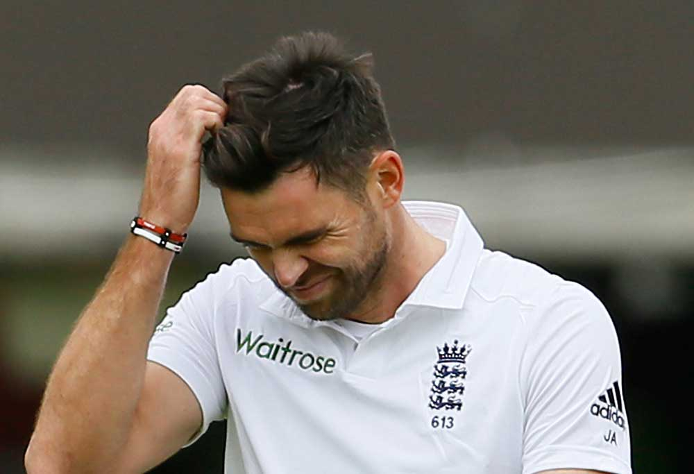 England's bowler James Anderson grimaces in frustration