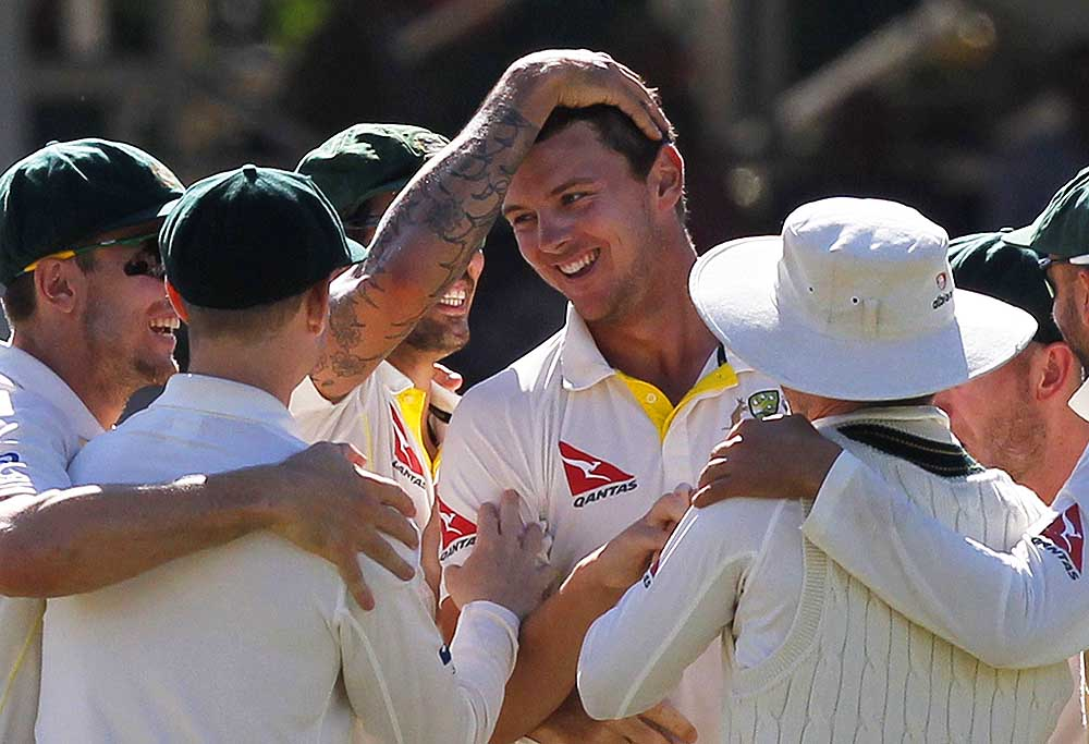 Australia's Josh Hazlewood (C) celebrates bowling out Englands Joe Root