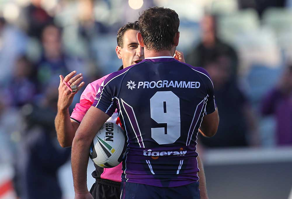 Referee Gerard Sutton explains why a try was disallowed to Storm captain Cameron Smith